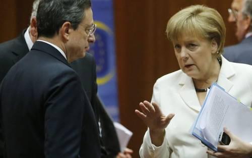 Lo scatto di Draghi il muro della Merkel