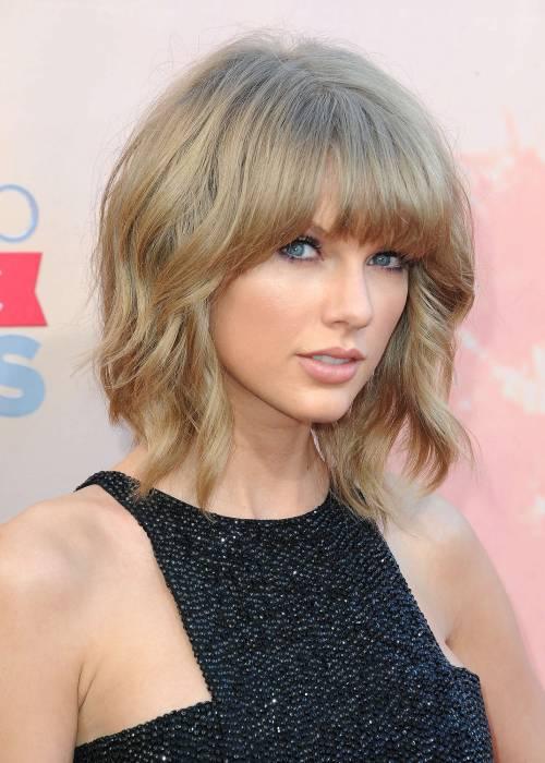 Taylor Swift sexy agli iHeartRadio Music Awards: vince e duetta con Madonna 23