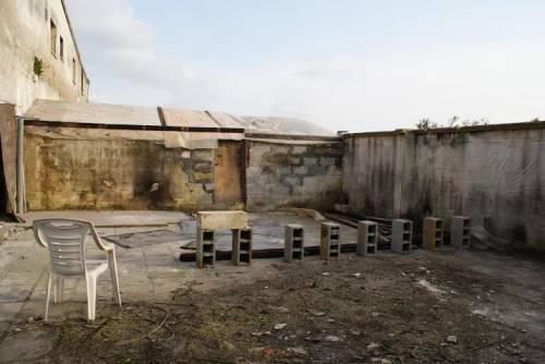 Il ghetto, la baraccopoli dei braccianti africani 6