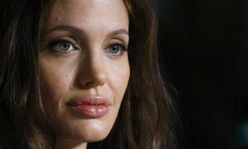 """Angelina Jolie: """"non ho mai pensato a me stessa come a una madre"""". Le foto 13"""