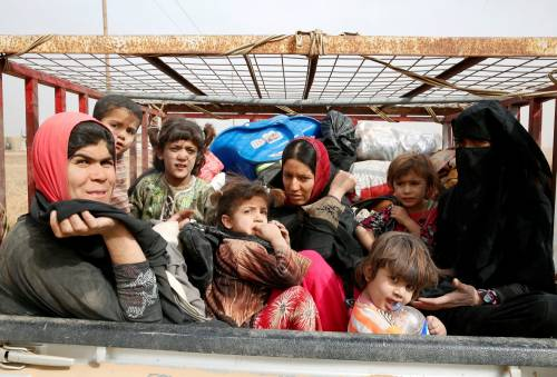 Così i civili scappano  dalla Mosul assediata 6