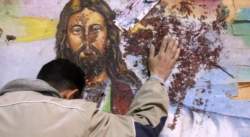 La rivincita sul Califfato: i bambini battezzati nella chiesa distrutta da Isis