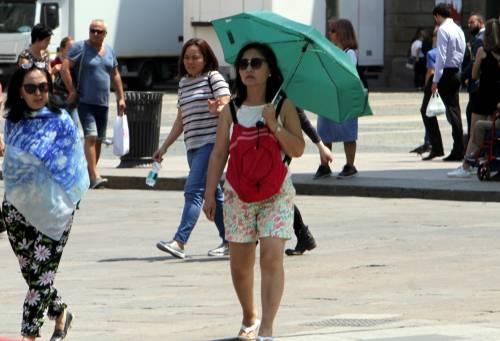 Caldo rovente a Milano e Roma: foto 10