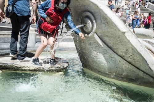 Caldo rovente a Milano e Roma: foto 6