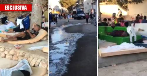 Migranti ammassati per terra. A Lampedusa l'hotspot è un inferno
