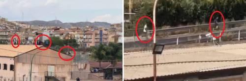 La rivolta dei migranti sul tetto per sfuggire alla quarantena