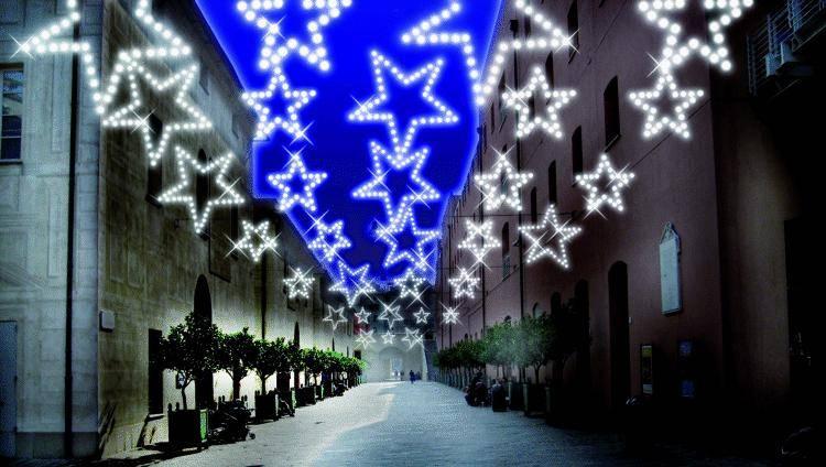 Cascata di luci al Porto Antico sul cioccolato e Babbo Natale