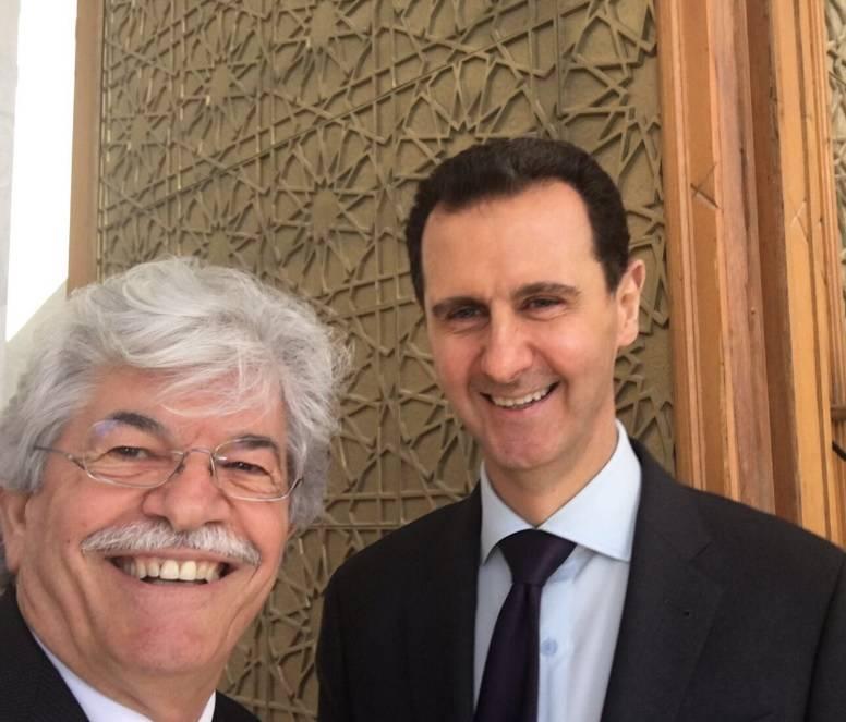 Razzi in visita da Assad